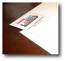 Glossy clear inkjet labels on white envelopes