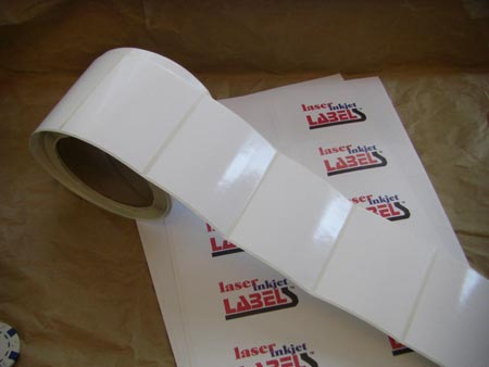 Glossy white adhesive labels in sheets or rolls